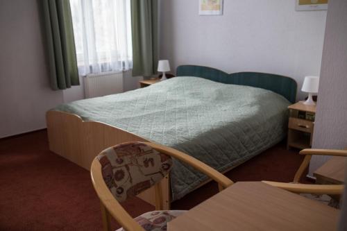 Łóżko lub łóżka w pokoju w obiekcie Hotel Reymont