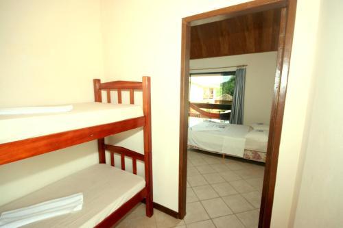A bunk bed or bunk beds in a room at Pousada Aldeia Mar