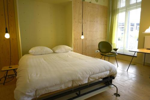 A bed or beds in a room at Labnul50 Groningen