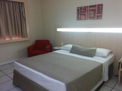 A bed or beds in a room at Hotel Vila Rica Belém