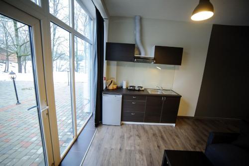 A kitchen or kitchenette at Glūdas Grava