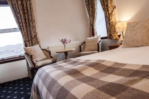 A bed or beds in a room at Poolewe Hotel