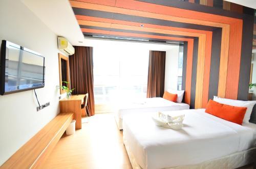 Cama o camas de una habitación en H-Residence