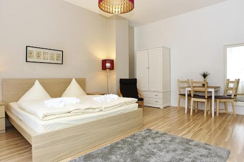 Ein Bett oder Betten in einem Zimmer der Unterkunft BearlinCity Apartments - City Center West