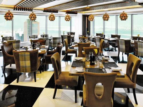 A restaurant or other place to eat at The Domain Bahrain Hotel and Spa