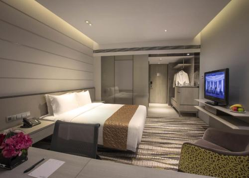 A bed or beds in a room at Carlton Hotel Singapore (SG Clean)