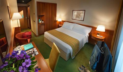 Säng eller sängar i ett rum på Hotel Cavour
