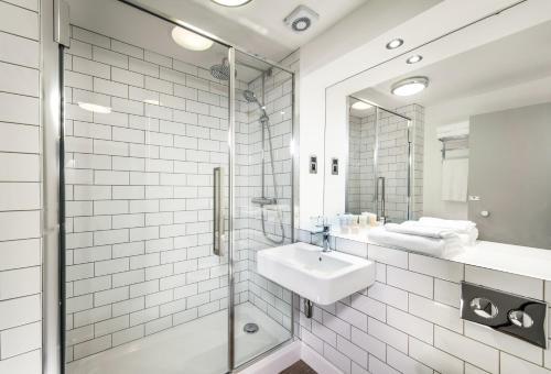 A bathroom at GoGlasgow Urban Hotel by Compass Hospitality