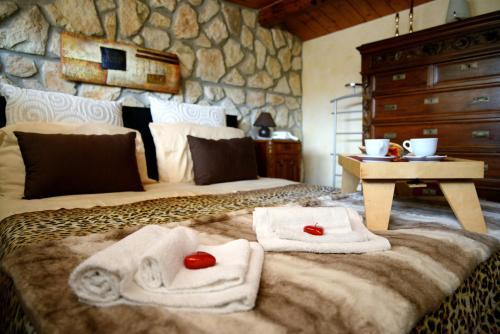 A bed or beds in a room at Alla Corte dei Ventimiglia