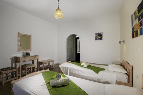 Ένα ή περισσότερα κρεβάτια σε δωμάτιο στο Kalathos Sun Hotel