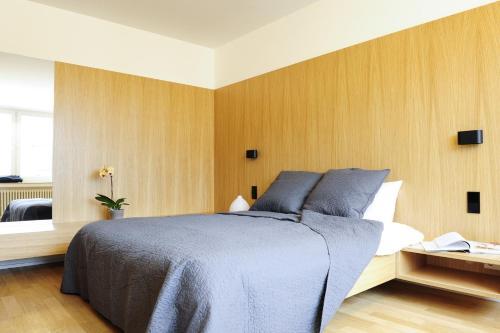 Ein Bett oder Betten in einem Zimmer der Unterkunft Key Inn Appart Hotel Parc de Merl