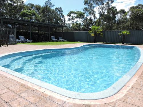 The swimming pool at or near Hermitage Lodge