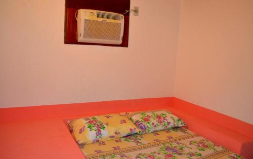 A bed or beds in a room at Pousada Em Busca do Sol