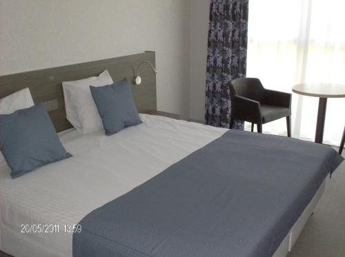 Een bed of bedden in een kamer bij Europahotel