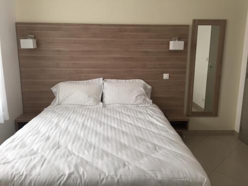 Postel nebo postele na pokoji v ubytování Le Logis Dauphinois