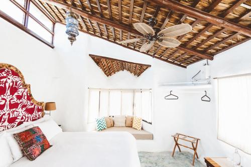Кровать или кровати в номере La Bohemia