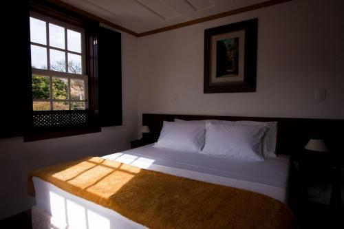 Cama ou camas em um quarto em Pousada Do Ouvidor