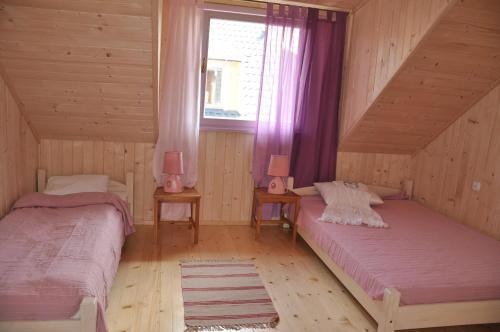 Łóżko lub łóżka w pokoju w obiekcie Lawendowa Wyspa Klub Nadmorski