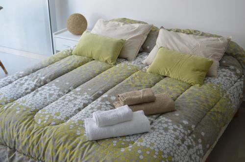 A bed or beds in a room at Apartamento Ocio