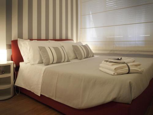 A bed or beds in a room at La Cittadella