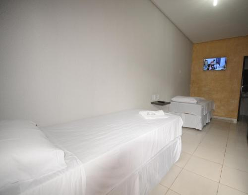 A bed or beds in a room at La Bella Hotel