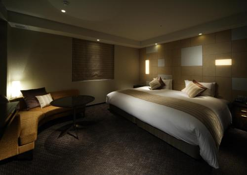 A bed or beds in a room at Hotel Il Palazzo