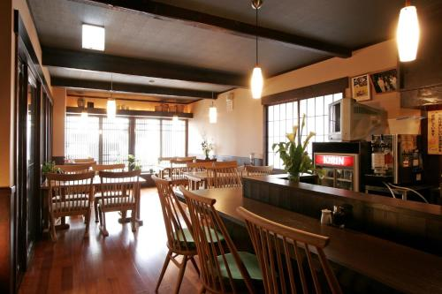 A restaurant or other place to eat at Henmi Ryokan