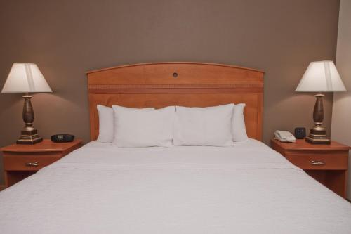A bed or beds in a room at Hampton Inn Decatur/Forsyth
