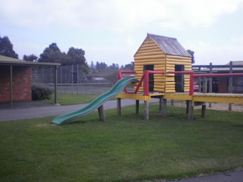 Children's play area at Best Western Colonial Village Motel