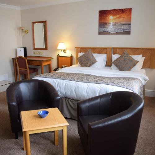 A bed or beds in a room at The Sefton