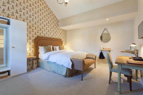 A bed or beds in a room at The Inn West End