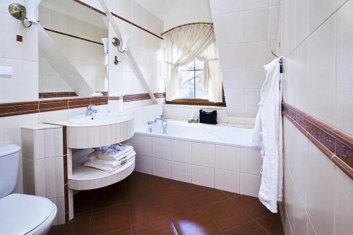 Łazienka w obiekcie Pokoje Szlacheckie Gniazdo