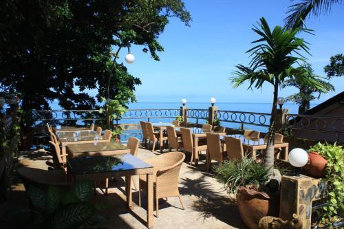 Ein Restaurant oder anderes Speiselokal in der Unterkunft Top Resort