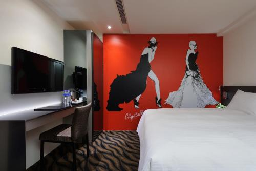 A bed or beds in a room at Taipei Morning Hotel