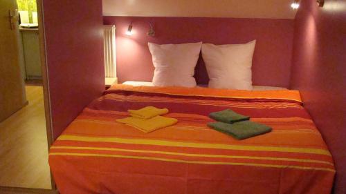 Łóżko lub łóżka w pokoju w obiekcie MV Apartamenty Komfort