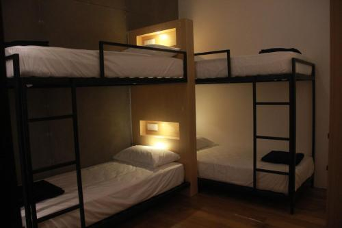 A bunk bed or bunk beds in a room at The 80's Guesthouse