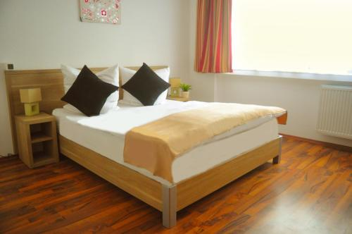 A bed or beds in a room at Hotel Platinium