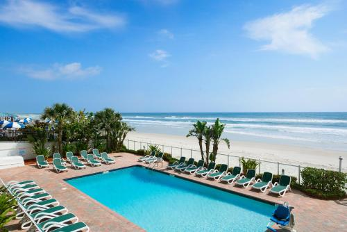 The swimming pool at or near Days Inn by Wyndham Daytona Oceanfront