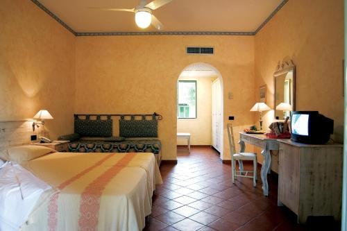 Letto o letti in una camera di Hotel Club Baia Samuele