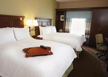 A bed or beds in a room at Hampton Inn and Suites Monroe