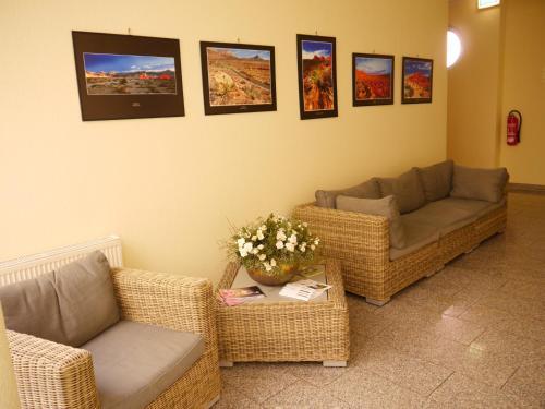 Ein Sitzbereich in der Unterkunft Garni-Hotel zum alten Ratskeller
