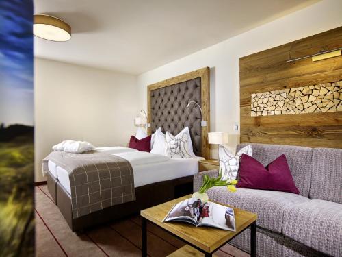 Ein Bett oder Betten in einem Zimmer der Unterkunft Hotel Innsbruck