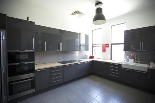 A kitchen or kitchenette at EBS Sydney Hostel