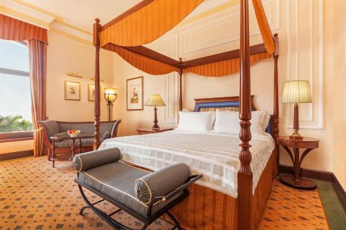 A bed or beds in a room at The Oberoi Grand Kolkata