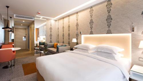 A bed or beds in a room at Tango Arjaan by Rotana Istanbul Asia