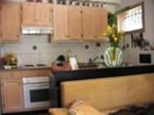 A kitchen or kitchenette at La ptit'Duch