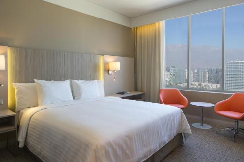 A bed or beds in a room at Courtyard by Marriott Santiago Las Condes