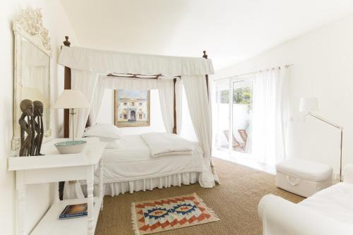 Cama o camas de una habitación en Casa la Concha Boutique Hotel