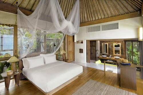 A bed or beds in a room at Six Senses Samui