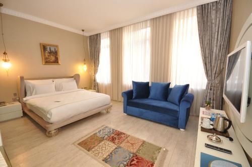 Säng eller sängar i ett rum på Nea Suites Old City